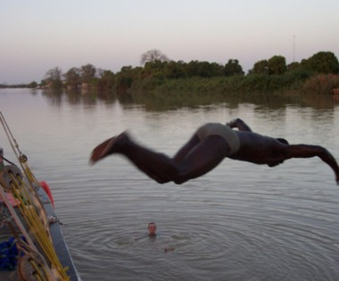 Swimming in the River Gambia off the Side of the Boat   * (Kuntaur is just in the distance)